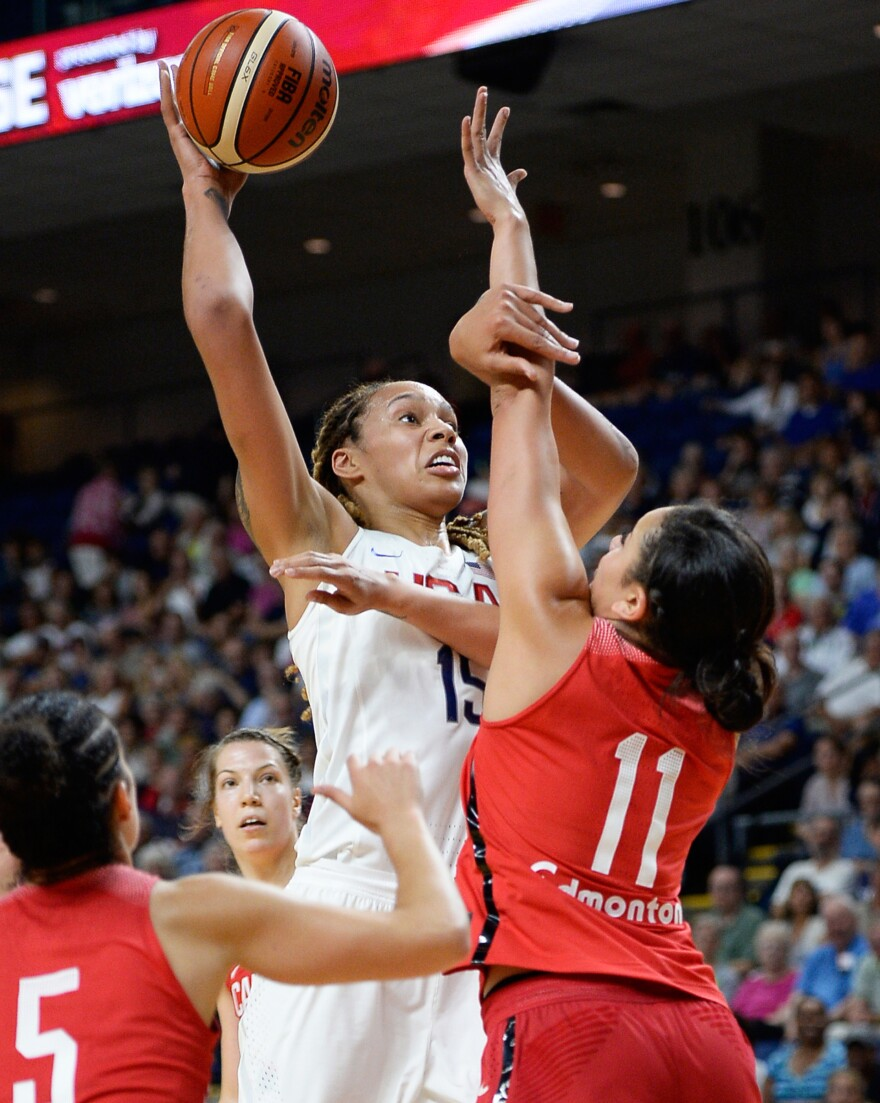 United States' Brittney Griner shoots against Canada's Natalie Achonwa during an exhibition basketball game on July 29 in Bridgeport, Conn. The U.S. women's basketball team has won 41 straight games at the Olympics and is going for its sixth straight gold medal.