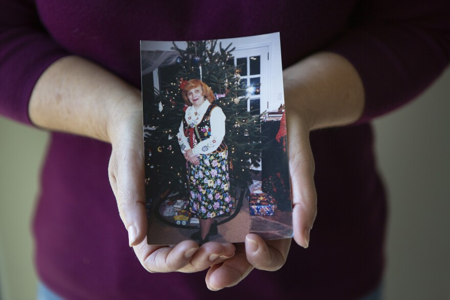 "Dorothy Cassaro holds a photograph of her mother, Annette. ""My mom died among strangers,"" she said."