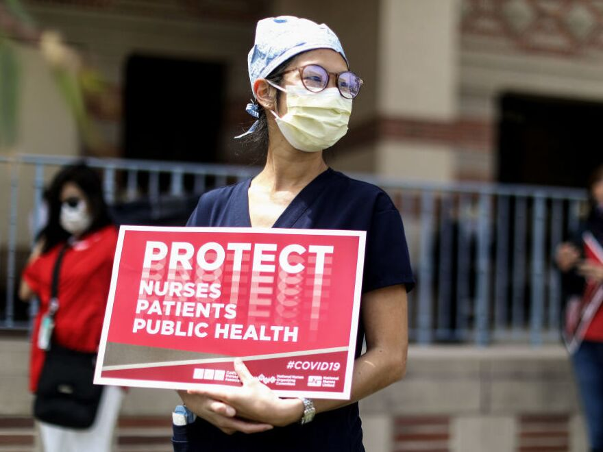 Registered nurses and other health care workers at UCLA Medical Center in Santa Monica, Calif., protest in April what they say was a lack of personal protective equipment for the pandemic's front-line workers.
