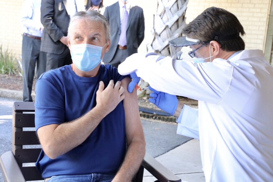 A long-term facility staff member gets the COVID vaccine in December.