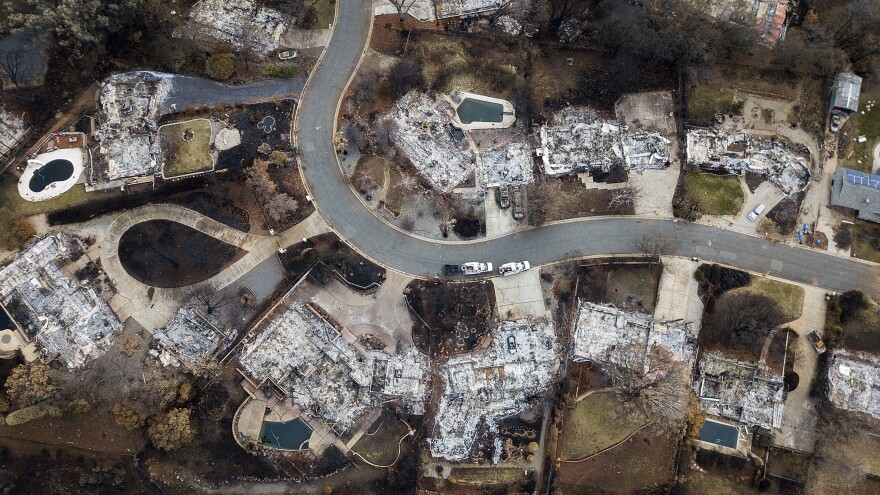 Homes leveled by the Camp Fire line Valley Ridge Drive in Paradise, Calif. Some recovery efforts are stalled by the government shutdown, creating anxiety among survivors and concern for officials.
