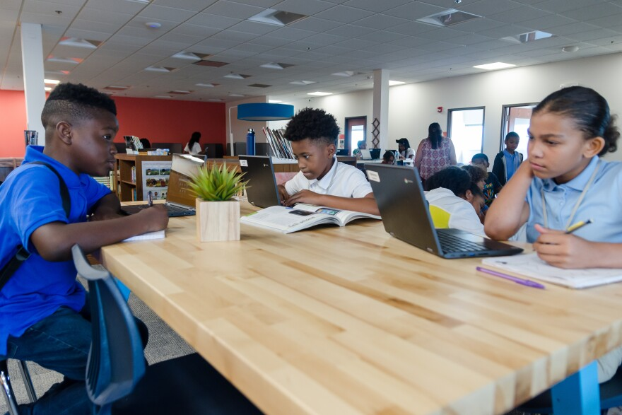 Students work in the library of Kairos Academies, a charter middle school with a non-traditional learning model that opening in St. Louis. Aug. 15, 2019.