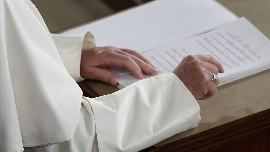Pope Francis reads from his prepared remarks as he addresses a joint meeting of Congress.