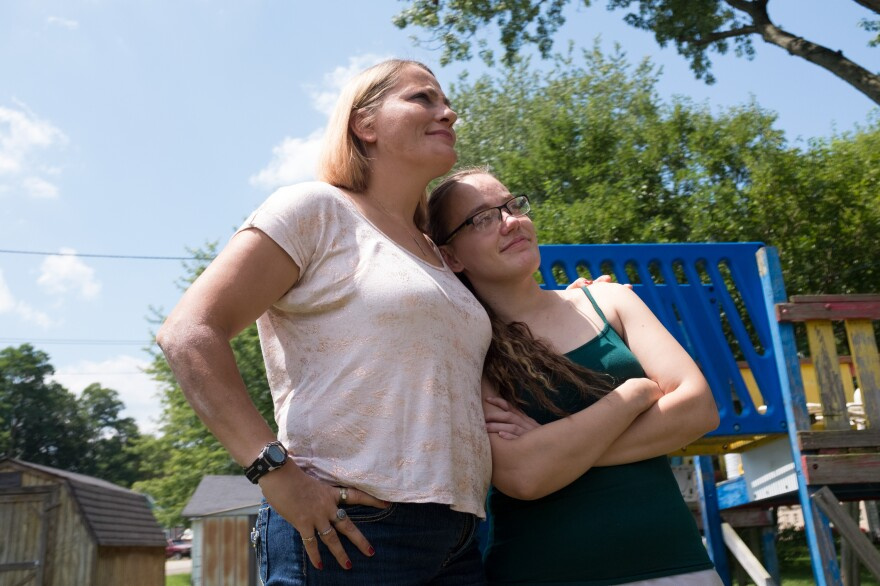 Katiena Johnson stands with her daughter Destini, who was released from jail in August. Katiena and her husband, Roger, took care of their grandchildren while Destini was struggling through her addiction. Destini, 27, recently regained consciousness after suffering a dozen or so strokes as a result of her latest opioid overdose.