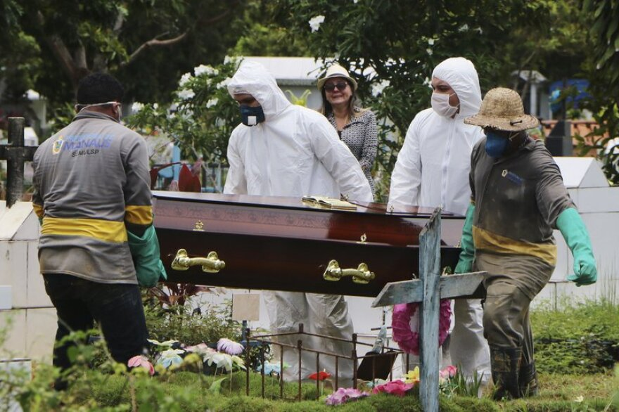 A Brazilian COVID-19 victim is buried in Manaus in northern Brazil.