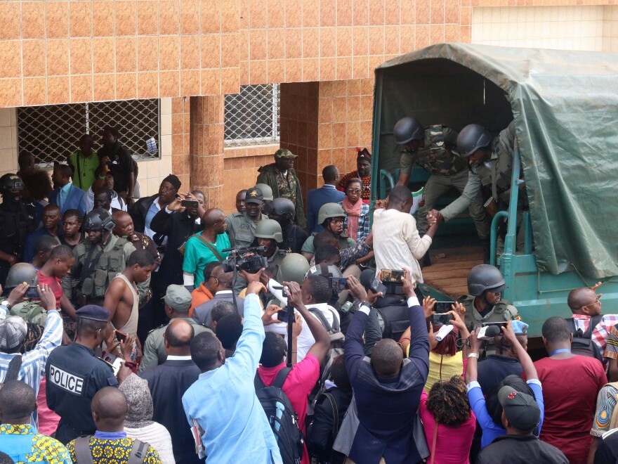 Schoolchildren who were kidnapped by armed men were released and helped into a truck by police in Bamenda, Cameroon, on Wednesday.