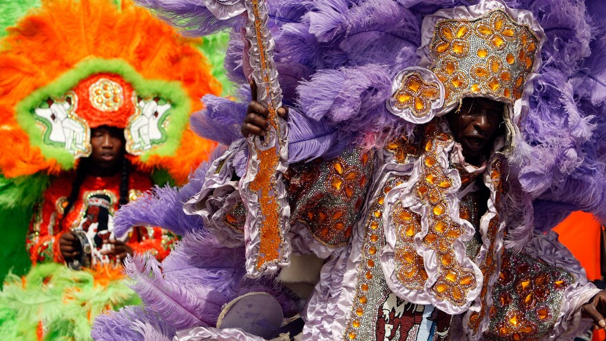 Members of the Wild Red Flame Mardi Gras Indians, photographed during Jazz Fest in 2008.