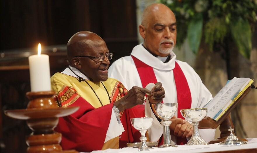 Anglican Archbishop Emeritus Desmond Tutu (left) celebrates Mass on his 85th birthday at St. George's Cathedral in Cape Town, South Africa, on Oct. 7. Tutu has called for the right to assisted death, which is currently illegal in his country.