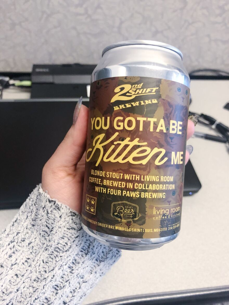 """Suzie Emiliozzi and her husband's home brewery, Four Paws Brewing, collaborated with 2nd Shift Brewing to create the """"You Gotta Be Kitten Me"""" blonde stout with Living Room coffee."""