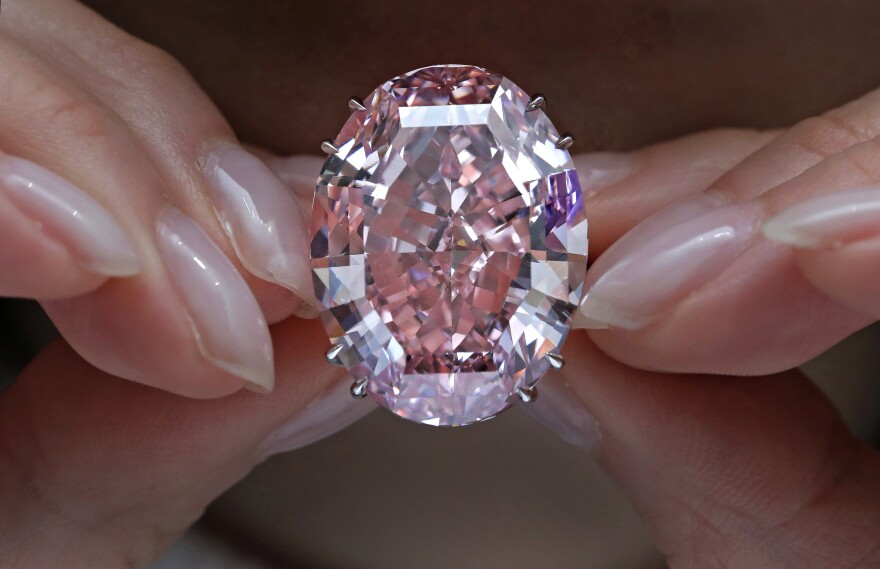 The Pink Star diamond, which fetched the highest price ever for a jewel offered at auction, is displayed at Sotheby's in Hong Kong on March 29.