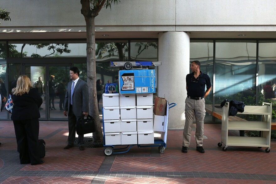 Samsung Electronics Co. representatives wait to enter the Robert F. Peckham Federal Courthouse in San Jose, California on Monday.