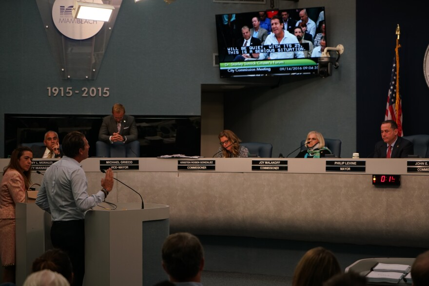 Miami-Dade County mayoral candidate Raquel Regalado and Michael Capponi, a tourism promoter, address Miami Beach city commissioners during a public comment period on Wednesday.