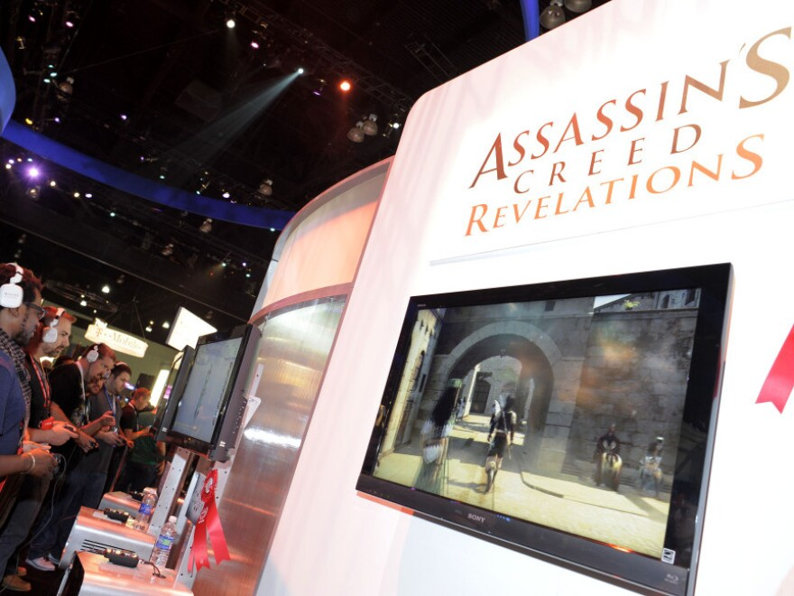 Gamers play Ubisoft's video game <em>Assassin's Creed</em> at the Electronic Entertainment Expo (E3) on June 9 in Los Angeles. The Supreme Court ruled Monday that California could not block minors from purchasing violent video games.