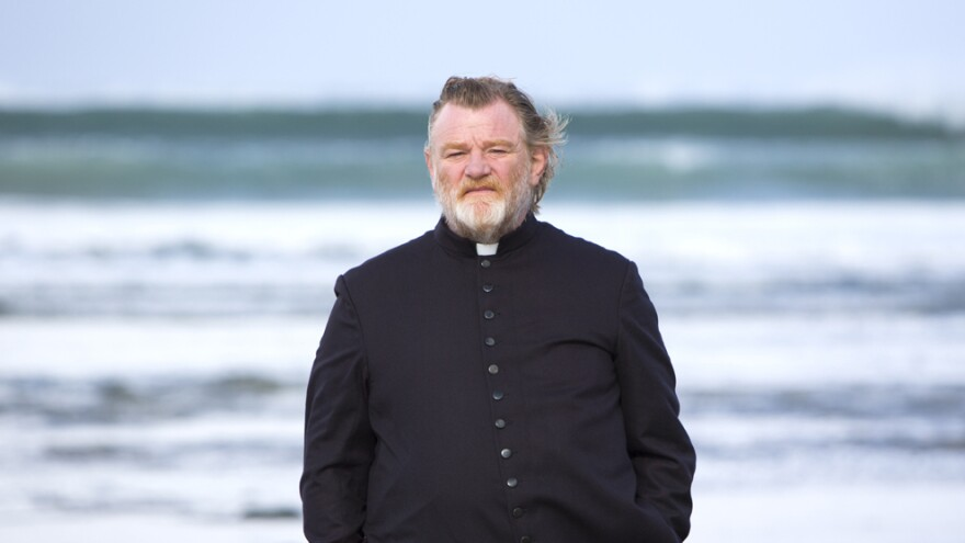 Brendan Gleeson, as tough-minded Father James, faces a death threat from an angry parishioner in the darkly comic new <em>Calvary</em>.