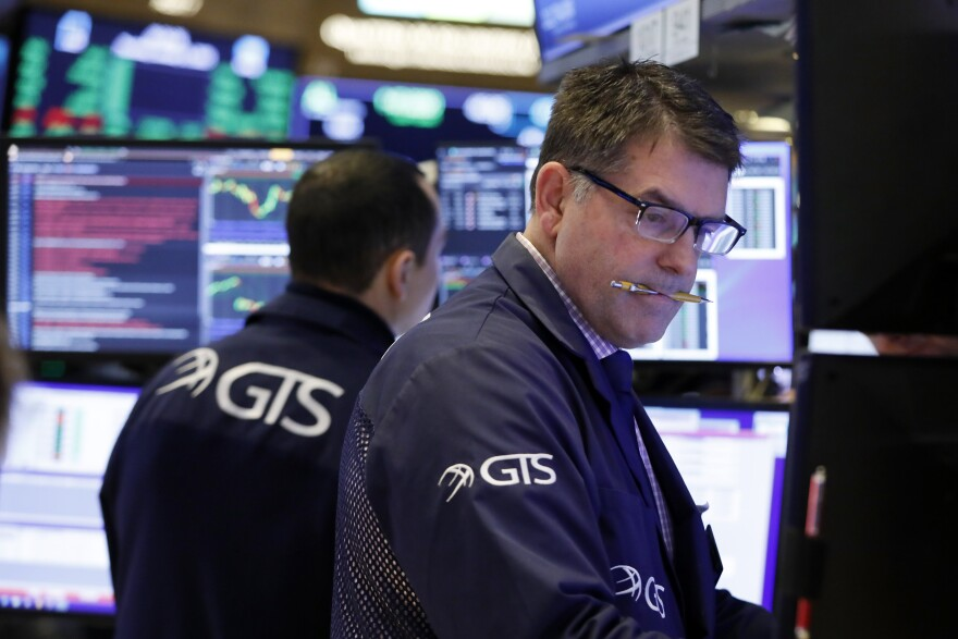 Specialist David Haubner works on the floor of the New York Stock Exchange, Thursday, Jan. 9, 2020. Stocks are opening broadly higher on Wall Street as traders welcome news that China's top trade official will head to Washington next week to sign a preliminary trade deal with the U.S.