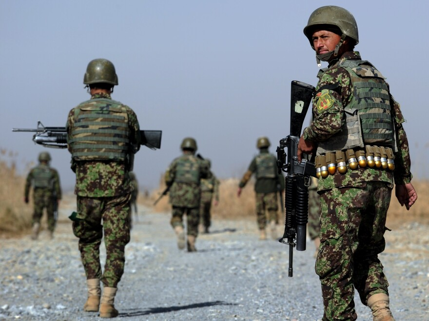 Afghan soldiers patrol a rural road near in southern Afghanistan. U.S. forces will continue to train Afghans on logistics and intelligence collection.