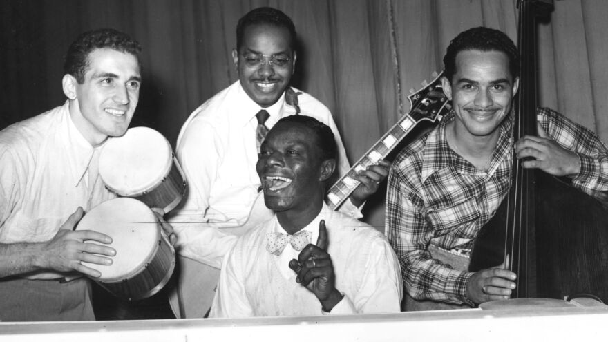 Nat King Cole (center) rehearses with his trio at the London Palladium in 1950.