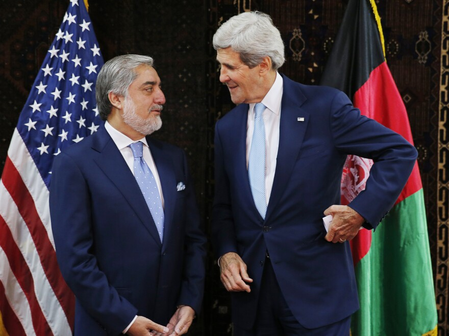 U.S. Secretary of State John Kerry talks with Afghan presidential candidate Abdullah Abdullah at the start of a meeting at the U.S. Embassy in Kabul on Friday. Kerry sought Friday to broker a deal between Afghanistan's rival presidential candidates.