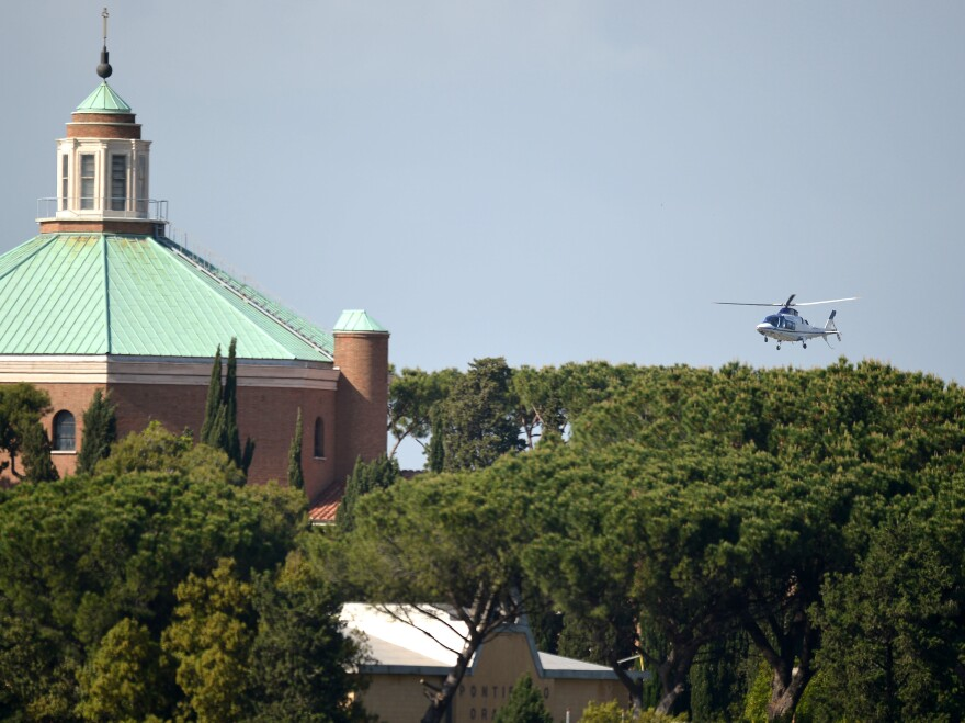The helicopter carrying Pope Emeritus Benedict XVI lands at the Vatican on Thursday.