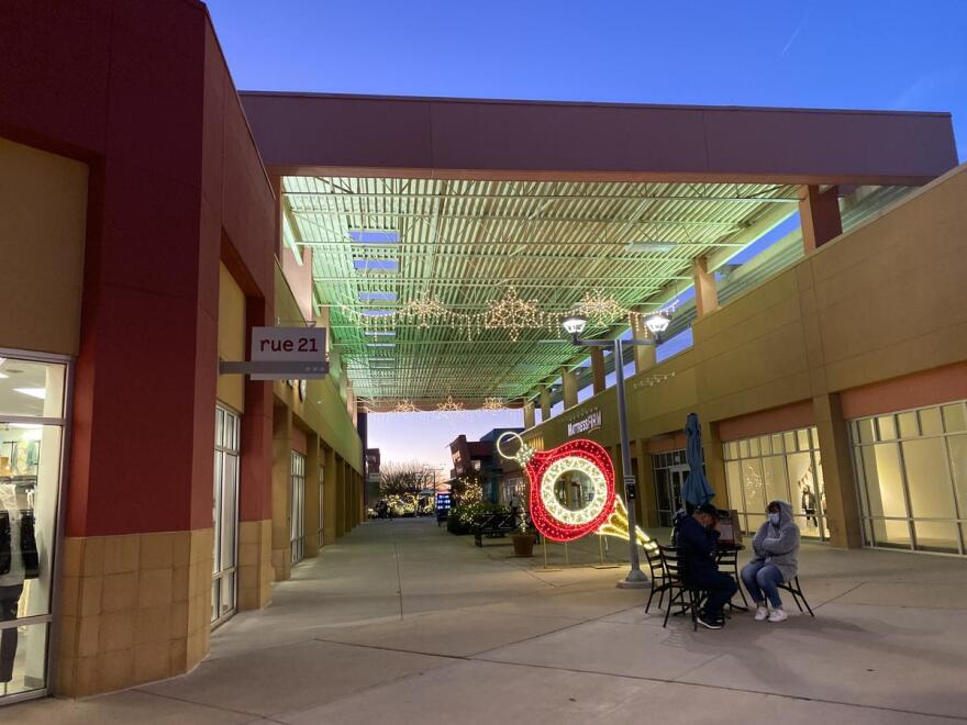 The Outlet Shoppes of El Paso sets a festive mood during the Christmas season. Pandemic border travel restrictions mean shoppers from Mexico won't be spending money at the open-air mall.