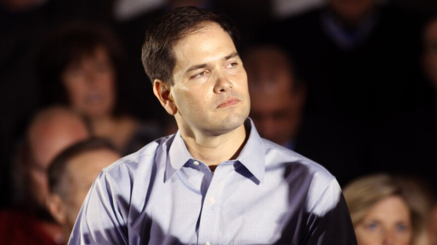 Sen. Marco Rubio, R-Fla., the son of Cuban immigrants, has urged his fellow conservatives to soften their rhetoric on illegal immigration. Above, he makes a campaign stop with Republican presidential candidate Mitt Romney on Monday in Aston, Pa.