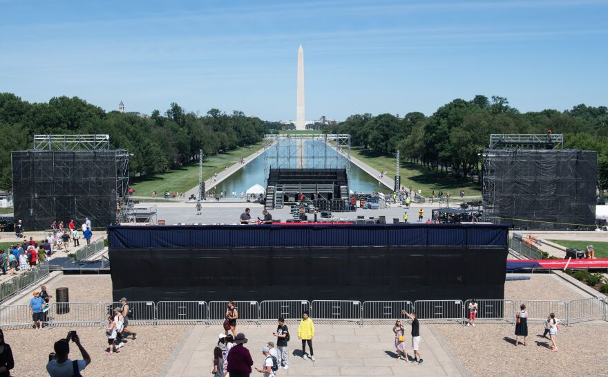 "Workers build a stage and bleachers Monday for the ""Salute to America"" Fourth of July event with President Trump at the Lincoln Memorial on the National Mall."