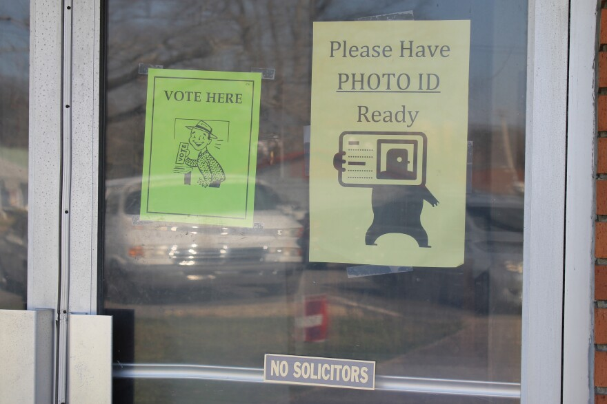 A sign at the door of a Little Rock polling location in March 2014 advises voters to have a photo ID ready.