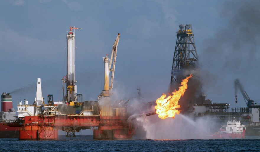 Vessels operate in the area of the Deepwater Horizon disaster on the Gulf of Mexico, Tuesday, July 13, 2010. BP officials have placed a containment cap over the leak in hopes that the flow of oil will be diminished.