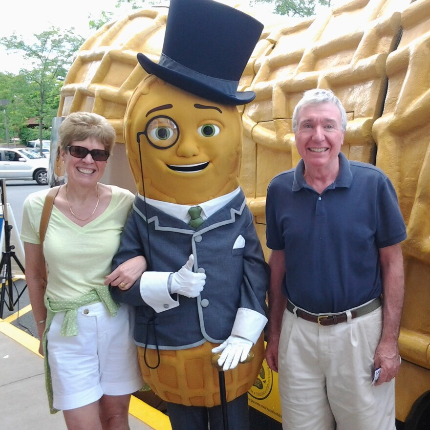Dashing at any hour, Mr. Peanut refuses to remove the monocle even for this snapshot with one lucky couple.