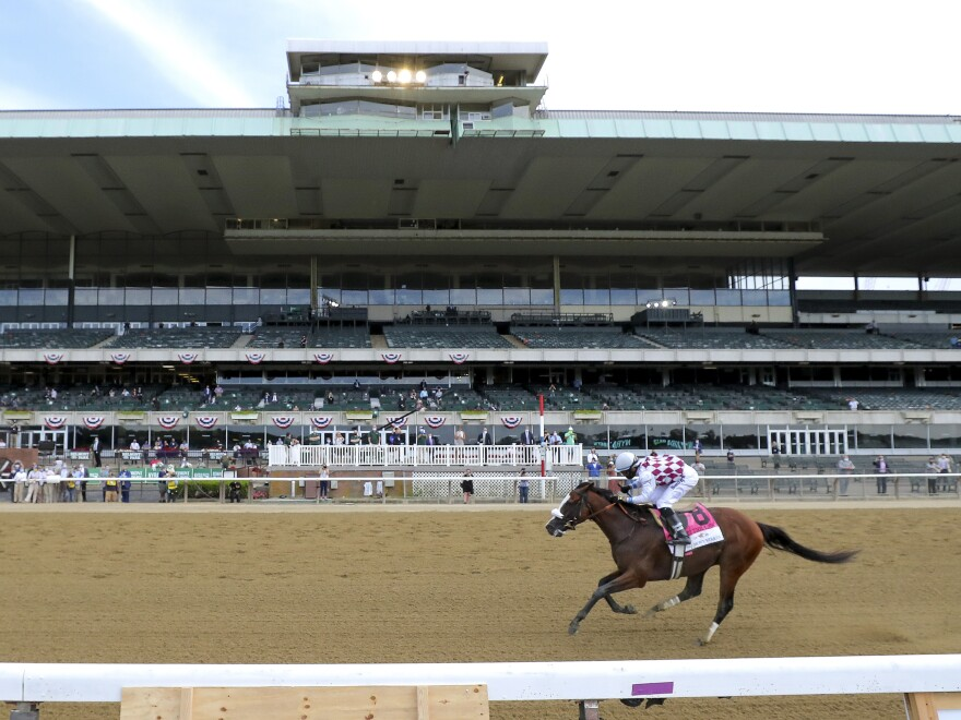 Tiz the Law, with jockey Manny Franco, crosses the finish line Saturday in front of an empty grandstand to win the 152nd running of the Belmont Stakes horse race in Elmont, N.Y.