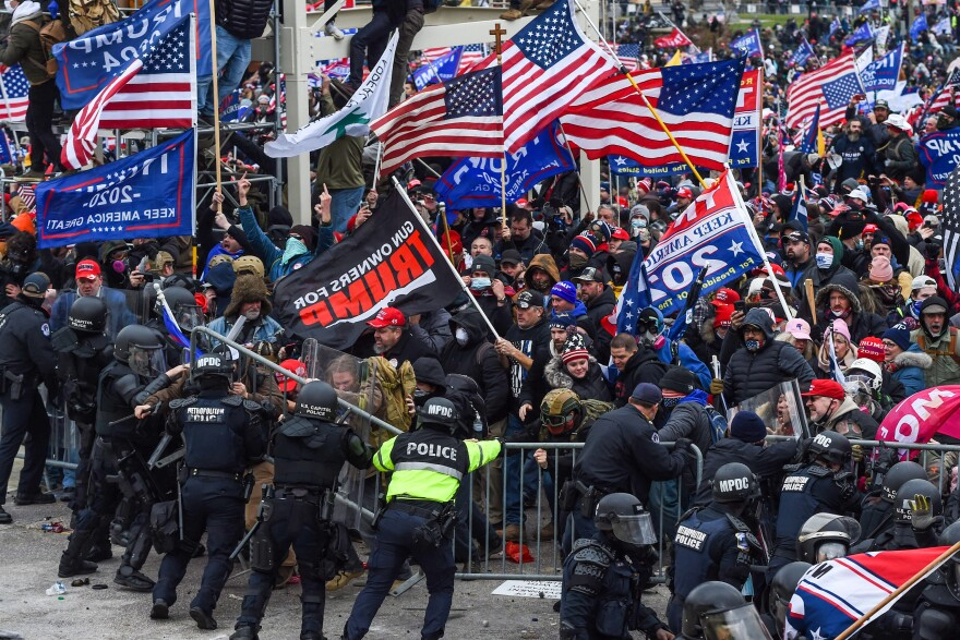 Police and security forces attempt to hold back a mob of pro-Trump extremists as they storm the U.S. Capitol in Washington on Wednesday.