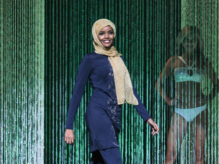 """Halima Aden wore a navy blue, embroidered burkini --€"""" a full-body bathing suit --€"""" during the swimsuit competition."""