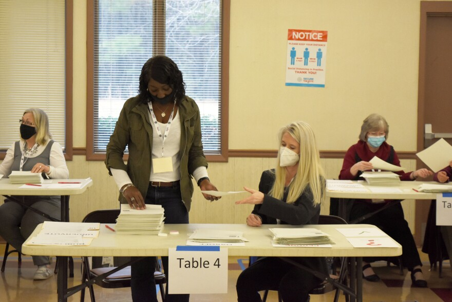 Bartow County, Ga. election workers conduct a full hand count of ballots in the Jan. 5 Senate runoff between former Sen. David Perdue and Sen.-elect Jon Ossoff as part of a voluntary recount aimed at improving voter confidence.