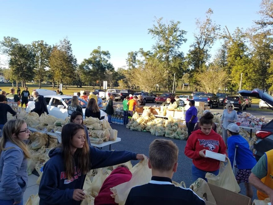 Volunteers distributing donations