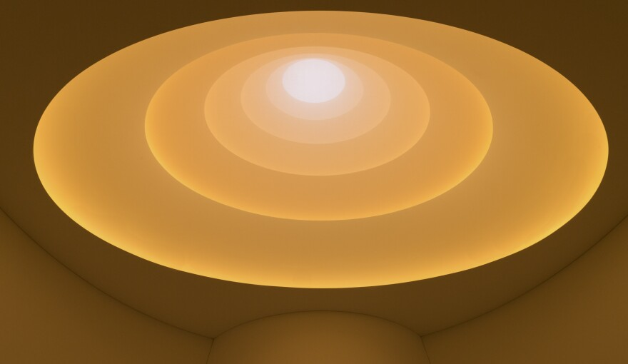 In <em>Aten Reign</em>, Turrell uses natural daylight and artificial LED light to create an immersive experience of illumination and color in the rotunda of the Guggehneim, which was designed by Frank Lloyd Wright.