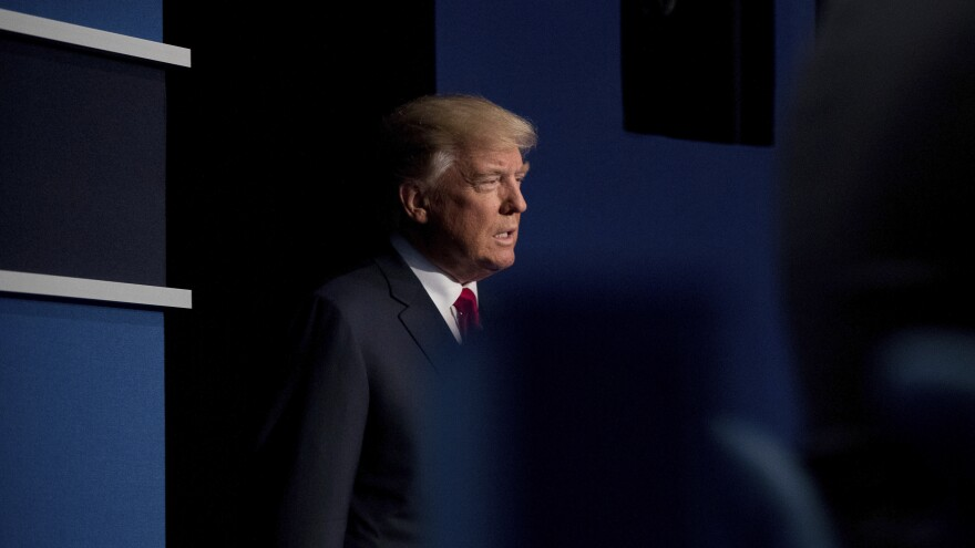 Then-candidate Donald Trump walks onstage at a presidential debate in St. Louis two days after a video was released, in which he is heard talking to <em>Access Hollywood</em> host Billy Bush about sexually assaulting women.