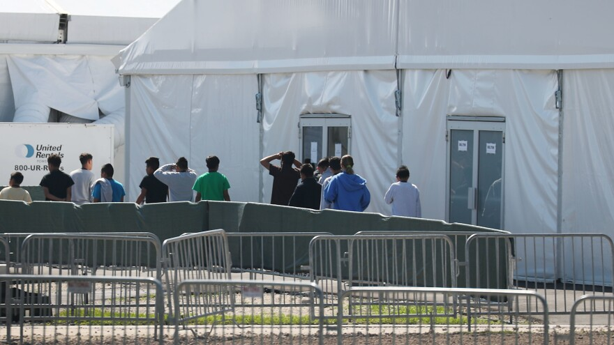 Roughly 130 shelters across the country are housing thousands of migrant children who arrived without their parents or were separated at the border. Children are seen here as they walk through the Homestead Temporary Shelter for Unaccompanied Migrant Children facility in Florida.