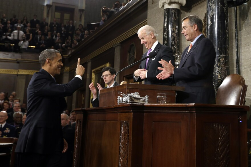 President Obama gestures to Vice President Joe Biden and House Speaker John Boehner before giving his 2013 State of the Union address.