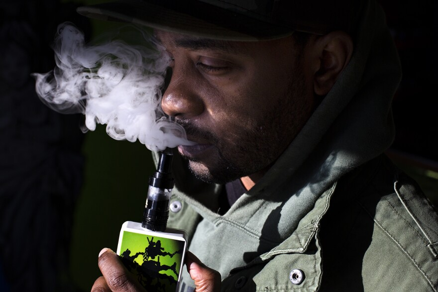 Murphy Lee poses for a portrait at Vape Ya Tailfeather in St. Charles.