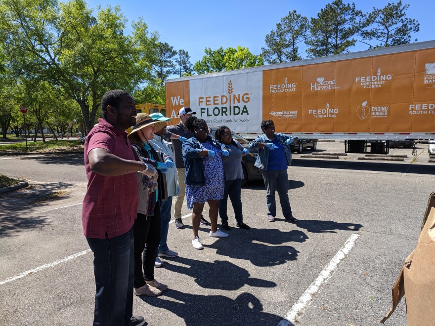 Volunteers pose for a group photo after a recent Feeding Florida partner food distribution in Tallahassee.