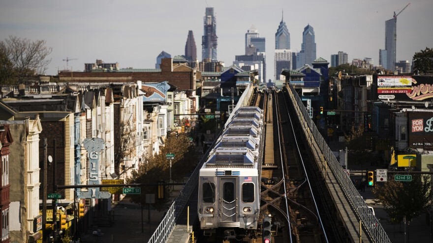 A train moves along the Market-Frankford Line in Philadelphia on Wednesday. Transit workers went on strike early Tuesday, shutting down bus, trolley and subways that provide about 900,000 rides a day.