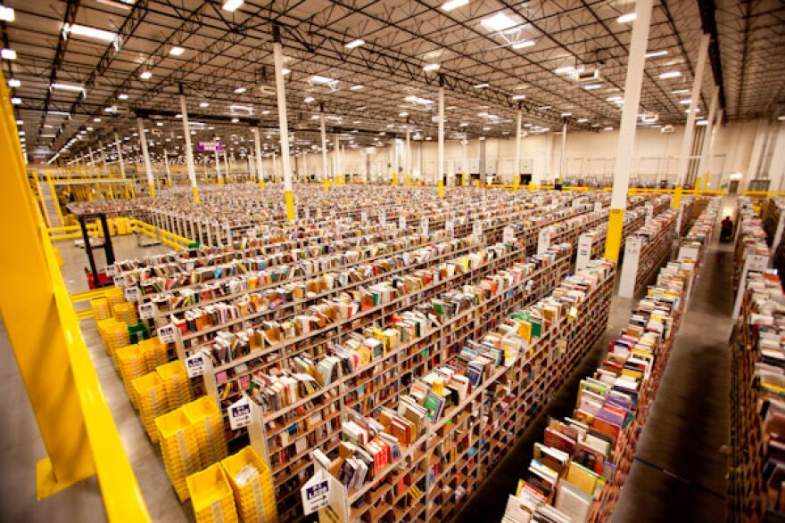 Photo of the inside of an Amazon warehouse.