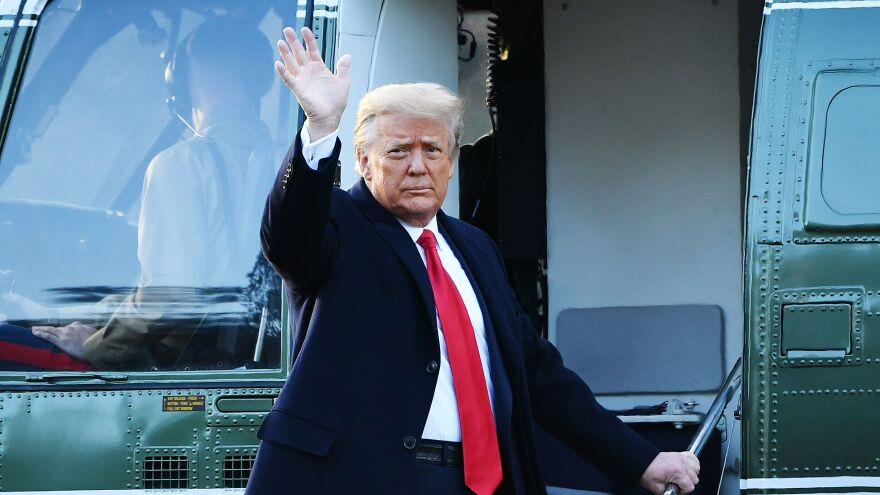 Outgoing President Donald Trump waves as he boards Marine One to leave the White House on Jan 20. Trump is now in Florida, observing his second impeachment trial from afar.