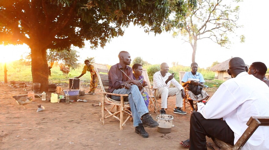 Neighbors and relatives share food, drink and conversation in Northern Uganda.