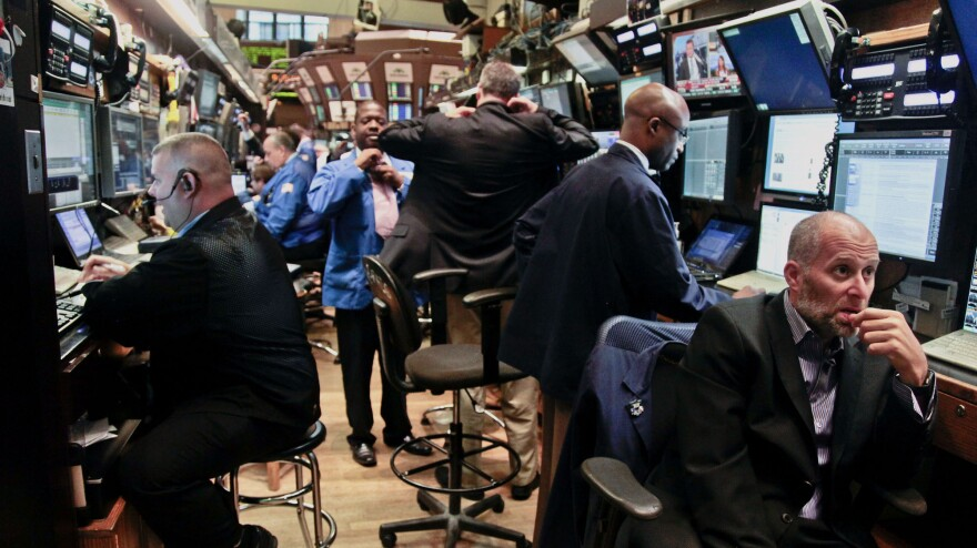 Traders prepare for the start of early trading at the New York Stock Exchange. Some say there's been a loss of faith in the stock market's return on investment over the last 15 years.
