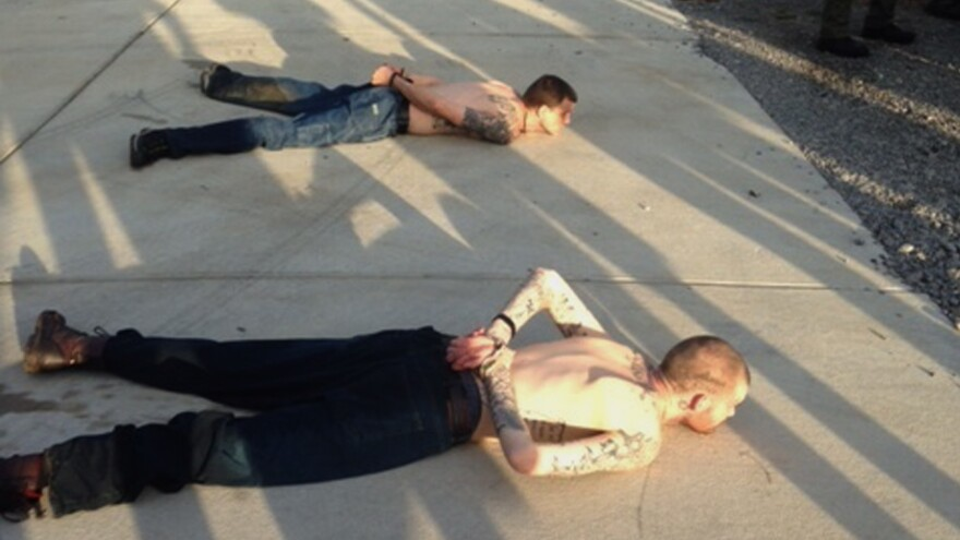 A Tennessee Bureau of Investigation photo shows the arrest of Georgia fugitives Donnie Rowe (top) and Ricky Dubose in Christiana, Tenn. The escaped inmates were captured Thursday in Tennessee after holding an elderly couple captive and leading police on a chase by car and foot, authorities said.