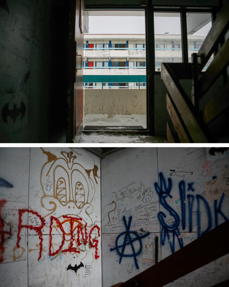 Graffiti covers the stairwell of an apartment block in central Nuuk.