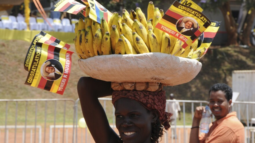 A woman sells bananas at the Kampala Airport. Ugandans eat about a pound of the fruit, on average, per day.