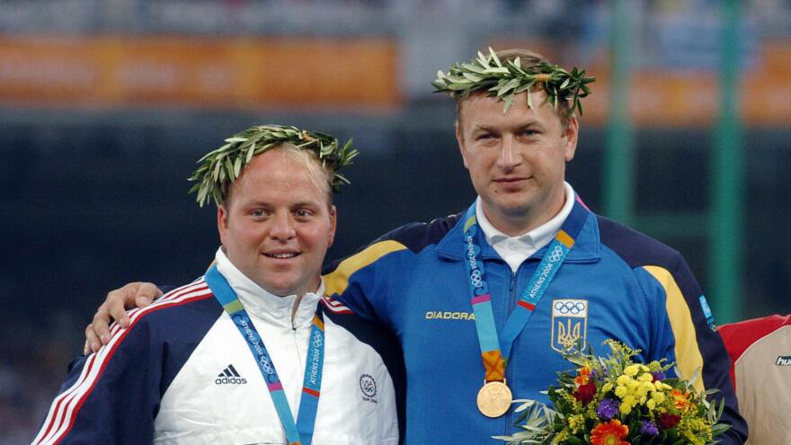 Gold medal winner Yuriy Bilonogof of Ukraine (right), wraps his arm around silver medal winner Adam Nelson of the U.S. on the podium for the shot put at the 2004 Olympic Games in Athens. However, Bilonogof was stripped of his gold in 2012 following a failed steroid test. Nelson was named the winner and honored at a ceremony on July 1 at the U.S. Olympic Trials in Eugene, Ore.