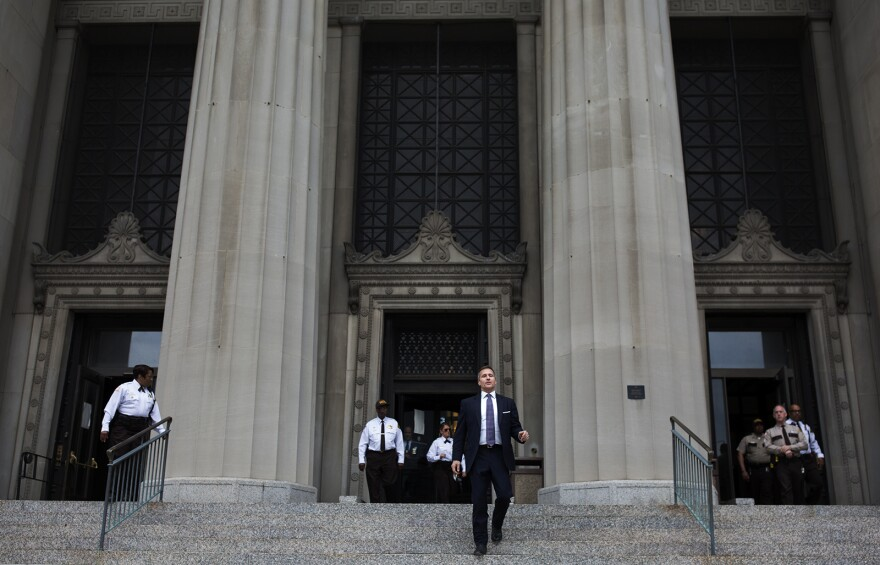 Missouri Governor Eric Greitens walks out of the Civil Courts Building in downtown St. Louis after his felony invasion of privacy charge was dropped. May 14, 2018